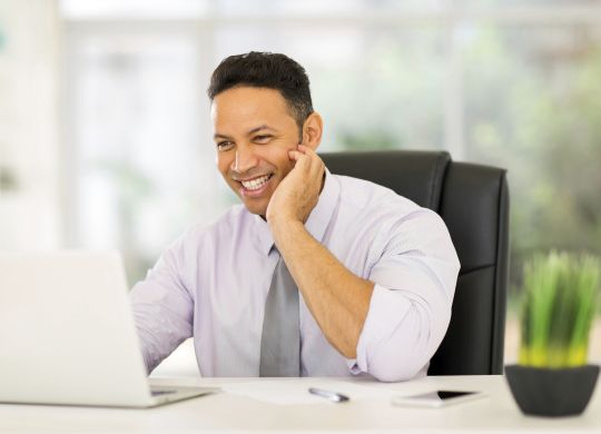 middle aged businessman working on laptop