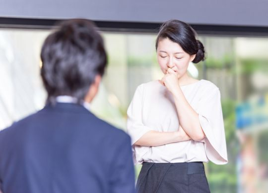 Japanese Businessman are listening woman's talking