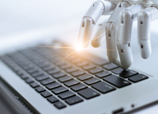 Robot finger point and working to laptop keyboard button, AI, Artificial Intelligence, Robotic hand on digital gray background. Futuristic technology concept. (Robot finger point and working to laptop keyboard button, AI, Artificial Intelligence, Robo